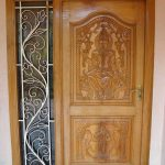 pintu rumah minimalis ukir patung budha